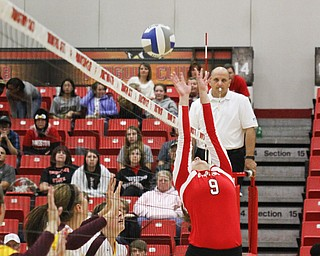 MADELYN P. HASTINGS | THE VINDICATOR  Erin Muir sets the ball over the net during the YSU Loyola game.