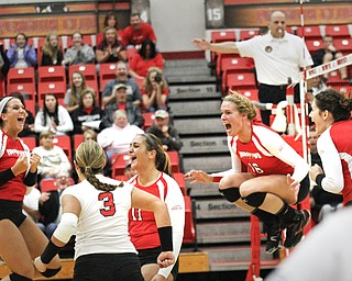 MADELYN P. HASTINGS | THE VINDICATOR  The girls celebrate after they score a point during the YSU Loyola game.
