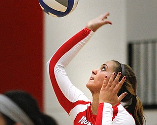 MADELYN P. HASTINGS | THE VINDICATOR  Casey D'Ambrose hits the ball during the YSU Loyola game.
