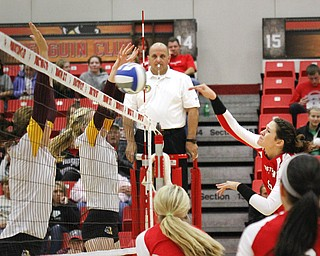 MADELYN P. HASTINGS | THE VINDICATOR  Shannon Watson hits the ball over the net during the YSU Loyola game.