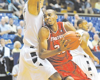 Youngstown State's Damian Eargle (21) is 15 blocks away from YSU's all-time record, but unlike the past few seasons, he'll have a little more help in the post this winter.