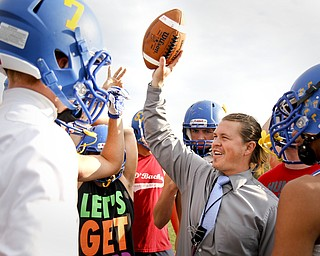 MADELYN P. HASTINGS   THE VINDICATOR  Southern Local High School football coach Mike Skrinjar cheers on the team after practice on October 4, 2012.