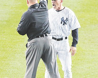 Yankees manager Joe Girardi is ejected by umpire Jeff Nelson after an argument over a missed call on a two out