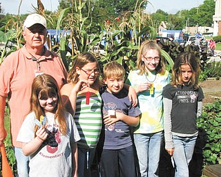 David Causer, educator, is shown with children in the youth garden program sponsored by the Men's Garden Club of Youngstown. From left are Greta Graffius, Alex Okelberry, Mike Wade, Katie McHugh and Daisy Gretsinger.