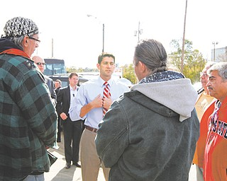 """Paul Ryan, the Republican vice-presidential nominee, spoke to a group of men outside the St. Vincent de Paul Society's Dining Hall in Youngstown on Saturday. The head of the society said Ryan used the facility for a """"publicity stunt."""""""