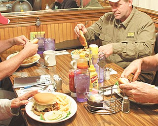 Burger guys from left: Anthony Fuda, John Spatar, Jerry Tranovich and Scott Long enjoy Tiger Burgers at Raptis in Howland.