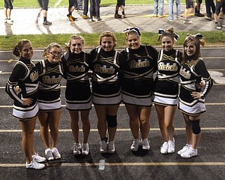 The Varsity Rebel cheerleaders: Lauren, Taylor, Alexis, Tiff, Amber, Chelsea, and Erika take a moment to pose on the track