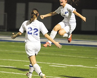 Poland's Victoria Harger (15) and Rachael Robertson (22) celebrate Harger's first goal in Wednesday's Division II sectional semifinal soccer match against Cardinal Mooney in Poland. The Bulldogs shut out the Cardinals, 3-0, to advance to the final.