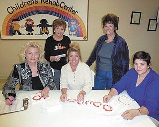 """Invitations have been mailed for the GFWC Ohio Warren Junior Women's League 43rd Annual Champagne Luncheon. Preparing invitations are, from left, Eddie Wolcott and Dorie Harris, decorations chairwomen; Julie Vugrinovich, event chairwoman; Karen Margala, president; and Lilli Radu, program chairwoman. This year's event, """"An Officer and a Gentlemen Christmas,"""" will be Nov. 16 at W.D. Packard Music Hall in Warren. Proceeds will benefit the Children's Rehabilitation Center Scholarship Fund so that no child will be turned away because of inability to pay for needed physical, developmental and speech therapy. If interested in attending, call Renee Maiorca at 330-637-8991 or Vugrinovich at 330-770-9806."""