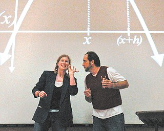 """Breona Conrad and Joshua Murphy performed """"Calculus: The Musical"""" on Thursday at Youngstown State University for more than 350 area high school students. The two take their show on the road and present a comical, entertaining way for kids to learn about math."""
