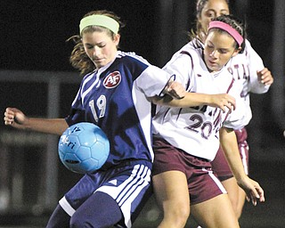 Fitch's Lauren Bower (19) tries to keep the ball from Boardman's Breana Crenshaw (20) during the Division I sectional final Thursday in Boardman. Alison Green powered the Spartans to a 5-1 victory over the Falcons with three consecutive goals.