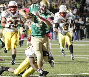 ROBERT K. YOSAY  | THE VINDICATOR..Big Gain as Ursulines  #13 Chirs Durking runs 50+ yards to set up an Ursuline TD and Ursuline never looked back .. trying to tackle is Mooney #2  Kareem Ellis  behind them #35   Anthony Dermotta  and #3  C J Bias Mooney @  Ursuline  YSU Stadium - Ursuline won 44-24 -... - -30-..