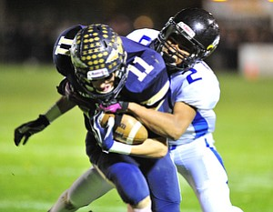 Youngstown Christian's #2 Darien Townsend hangs on to Brookfield receiver #11 Collin Harkulich after a reception.