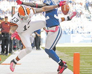 Browns wide receiver Josh Gordon (13) just misses a touchdown on this play against Colts cornerback Cassius Vaughn (32) during Sunday's NFL game in Indianapolis. Indianapolis edged Cleveland, 17-13, behind rookie QB Andrew Luck, who became the first Colts quarterback to run for two touchdowns in a game since 1988.