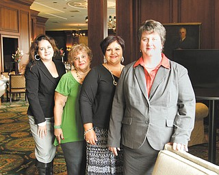 OCCHA will be celebrating 40 years of service during a scholarship banquet Friday at Mr. Anthony's Banquet Center. Among those involved with the event are Atty. Miriam Ocasio, board president, left; Virginia Hernandez and Maria Olverson, gala committee co-chairwomen; and Susan Nieves, executive director.  Photo by: ROBERT K. YOSAY  | THE VINDICATOR.