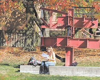 Amanda Huff man of Liberty, a sophomore at Youngstown State University, enjoys the unseasonably warm weather on campus. The area had a record-high temperature of 81 degrees Thursday, but the temperature will drop into the mid-40s by tonight and is expected to stay there through next Thursday.