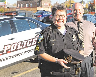 Lt. Rosemary Marsco of the Youngstown State University Police Department is the first woman in the department to rise to that rank. Chief John Beshara, right, promoted Marsco, who started with the department as a part-time
