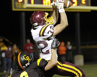 ROBERT  K.  YOSAY  | THE VINDICATOR --..South Range #32  Robert Seman jumps high for A TD pass above Crestview #2 Trevor Cope... during ....second  quarter.South Range at Crestview ..(AP Photo/The Vindicator, Robert K. Yosay)