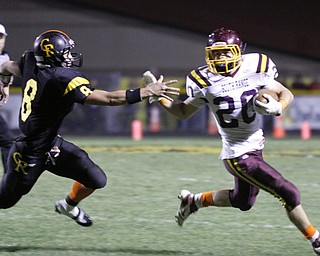 ROBERT  K.  YOSAY  | THE VINDICATOR --..South Range #20  Jake Arsuffi  eludes #8 Crestveiw matt Hardenbrook - as he makes a first down = second quarter.South Range at Crestview ..(AP Photo/The Vindicator, Robert K. Yosay)