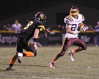 ROBERT  K.  YOSAY  | THE VINDICATOR --..South Range #20  Jake Arsuffi  eludes #8 Crestveiw matt Hardenbrook - as he makes a first down == second quarter..South Range at Crestview ..(AP Photo/The Vindicator, Robert K. Yosay)