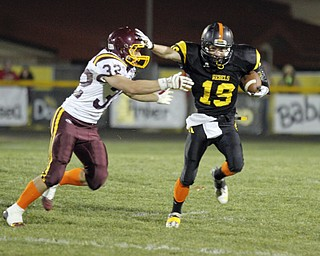 ROBERT  K.  YOSAY  | THE VINDICATOR --..Making his own block #19  Nick Blower  stiff arms #32 Robert Seman  as he runs for 12 yards and a first down-  first quarter.South Range at Crestview ..(AP Photo/The Vindicator, Robert K. Yosay)