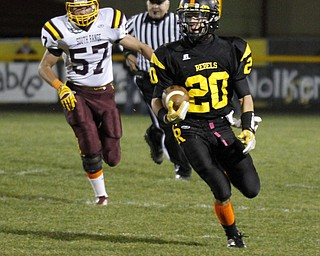 ROBERT  K.  YOSAY  | THE VINDICATOR --..Crestview #20   Kris Simpson runs for a big gain leaving South Range #57   Ryan Haynes....South Range at Crestview - - First Quarter...(AP Photo/The Vindicator, Robert K. Yosay)