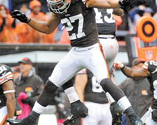 Browns safety Eric Hagg (27) and T.J. Ward celebrate after stopping the San Diego Chargers on fourth down in the final seconds of Cleveland's 7-6 win Sunday at Cleveland Browns Stadium. It was Cleveland's second victory of the season.