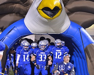 Vinny Brunner leads the team out for Senior Night as he is the #1 Hubbard Football Team Fan