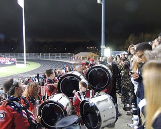 Senior band members join the spirit club in the student section during 3rd quarter of the last regular season game to lead some cheers to rally the falcons!