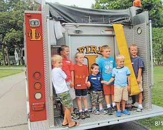 The Logan Brooke neighborhood in Liberty Township recently enjoyed its annual block party and were treated to a visit by the township's fire department. Kids of all ages learned about the firetruck and ambulance vehicles. Standing on the truck are, from left, Ethan Brookbank, Gregory Jones, Will and Matt Hynes, Anthony Garano and James and Patrick Jones.