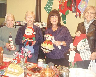 Sue Stoddart, left, Carol Olson, Sue Pechkurow and Linda Matheny show items for the Upton Christmas garage sale. The sale will be from 9 a.m. to 4 p.m. Nov. 16 and 17 at Upton House, 380 Mahoning Ave. NW, Warren. Donations are welcome and will be accepted from 9 a.m. to noon Nov. 12 or 1 to 4 p.m. Nov. 15. Christmas decorations, toys, housewares and jewelry are some of the items needed. Proceeds will benefit Upton House. Members willing to volunteer can email institches5848@aol.com. For information visit www.uptonhouse.org.