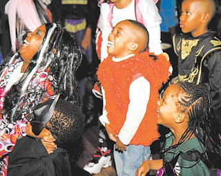 Children, dressed up for Halloween, laugh at the Black Knights Police Association's party at Youngstown's Wick Park Pavilion on Wednesday. About 100 kids attended.