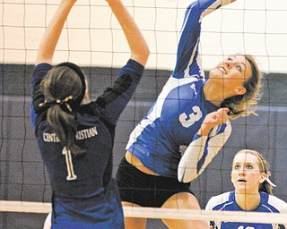 Jackson Milton's Rachael Obradovich (3) spikes the ball against Kidron Central Christian defender Natalie Swift (1) during the fourth game of Wednesday's Division IV regional volleyball semifinal at Solon High School. The Bluejays fell to the Comets, 3-1.