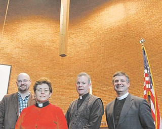 A group of Valley pastors is promoting a nonpartisan, ecumenical gathering on Election Day. From left are Bradley Pace of St. John's Episcopal in Youngstown, Julianne Smith of Prince of Peace in Poland, Duane Jesse of Zion Lutheran in Youngstown and Bill Wessner of New Life in Liberty.