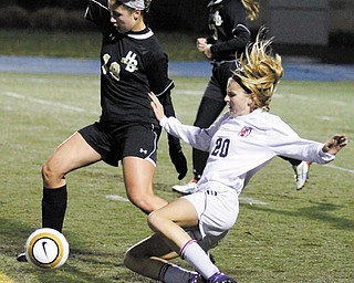 Canfield's Bailey Fischer (20) slides into the kick against Hathaway Brown defender Veronica Guastella (19) during