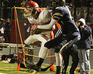 NICK MAYS l THE VINDICATOR (10) Riis Smith picks off a pass intended for (6) Don McFarland of Brookfield in the second quarter of thier game Friday night in Girard. ashtabula vs brookfield 11022012 Girard, Ohio