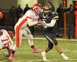 NICK MAYS l THE VINDICATOR (3) Ryan Mosora of Brookfield tries to break away from (36) Anthony Monda  of Edgewood in the first quarter of thier game Friday night in Girard. ashtabula vs brookfield 11022012 Girard, Ohio