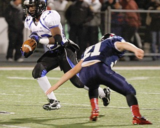 ROBERT K. YOSAY  | THE VINDICATOR..YCS  #23 Ryan Grier  makes a cut on JFK's 21 ???...First round of playoffs as  Warren JFK matched up with Youngstown Christian at Mollenkopf in Warren... - -30-..