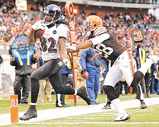 Baltimore Ravens wide receiver Torrey Smith (82) beats Cleveland Browns safety Usama Young to the goal line on a 19-yard touchdown catch with 4:26 left to play in Sunday's NFL game at Cleveland Browns Stadium.