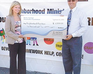 Neighborhood Ministries recently received a check for $2,000 from Home Savings Charitable Foundation. Mindy Wiesensee, left, AVP branch manager of McCartney Road Home Savings, is shown presenting the oversized check to Mark Samuel, executive director of Neighborhood Ministries. The funds will be used to support programs and services to low-income families and their children. For information about Neighborhood Ministries, call 330-755-8696 or email mark_samuel@ohionm.org.