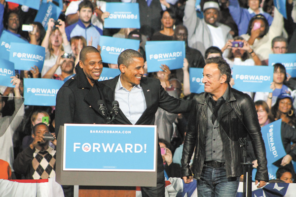 President Barack Obama is joined by musicians Jay-Z and Bruce Springsteen during an election eve rally Monday in Columbus. More than 15,000 people turned out for the event.