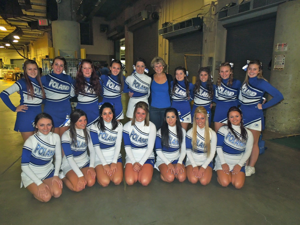 "Poland Seminary varsity and junior varsity cheerleaders pose before the performance at ""The Q"""