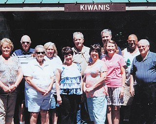 Members of Austintown Kiwanis recently had their annual picnic at Austintown Kiwanis Club Pavilion, built in the 1950s, in Austintown Township Park. Those who attended are, in front from left, Barb Kliner; Caryl Kloss; Karen Schnurrenberger; Mary Ann Herschel, president; Jennifer Kurish; and guest Chuck Whitman. In back are Bob Kloss, treasurer; Carole Powers, secretary; Dave Schnurrenberger; Mike Kurish; and Todd Shaffer, park superintendent. The club meets every Wednesday at noon at Austintown Community Church and guests are welcome for lunch. For information about what the club does in the community call 330-793-3087.
