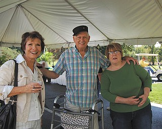 Whispering Pines Village, 937 E. Park Ave., Columbiana, its 10th anniversary recently. Residents, families, staff and guests enjoyed music, wine, appetizers and dessert. Participating in the festivities are, from left, Mary Burkey, Bob Buerkle and Sandy Havlin.