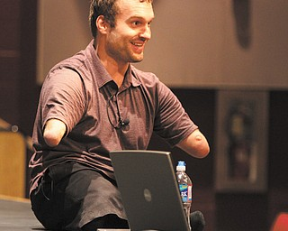 Motivational speaker Kyle Maynard, 26, addressed students from six school districts Wednesday during assemblies at South Range and Salem schools.