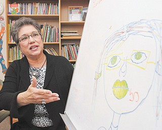 Carole J. Bopp, executive director of Hope House Visitation Center in Youngstown, shows a drawing made by a child who participates in supervised visitations at the center that serves Mahoning County.