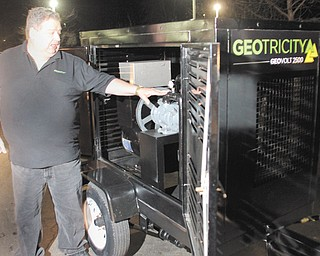 Ken Jackson of Glenmont, Ohio, shows off the GeoVolt 2500 during a meeting of the Youngstown-Warren Inventors Association.