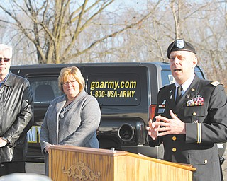 From left, Joe Kerola, president and CEO of P.I.&I. Motor Express, his wife, Pam Kerola, and Army Lt. Col. David P. Barlet, commander of U.S. Army Recruiting Battalion in Cleveland, finalized a partnership between the trucking business and the Army on Thursday. The agreement will allow preferential hiring for veterans interested in working for the company.