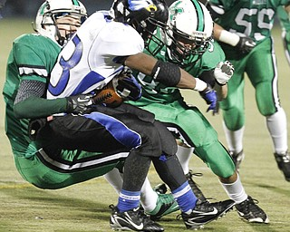 ROBERT  K.  YOSAY  | THE VINDICATOR --..YCS  Ryan Grier  is stopped by  Mogadores  # 82 Kasey Beard and #92 (underneath  Matt Nolfi during  first quarter action -..YCS  vs Mogadore  at  Ravenna...(AP Photo/The Vindicator, Robert K. Yosay)