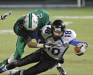 ROBERT  K.  YOSAY  | THE VINDICATOR --..During first quarter action YCS #18  Ryan Coyier reaches for more yards as he is brought down by Mogadore #2  Hunter Van Camp.YCS  vs Mogadore  at  Ravenna...(AP Photo/The Vindicator, Robert K. Yosay)